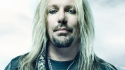 Vince Neil suffers broken ribs after falling from stage