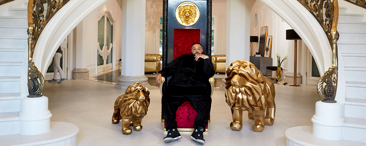 DJ Khaled on a throne flanked by two lion statues
