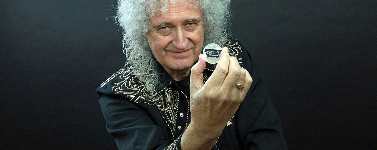 Brian May with Queen £5 coin